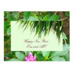 Postal del Año Nuevo de la palmera y del rododendr