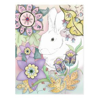 Postal del conejo del jardín de la puesta del sol