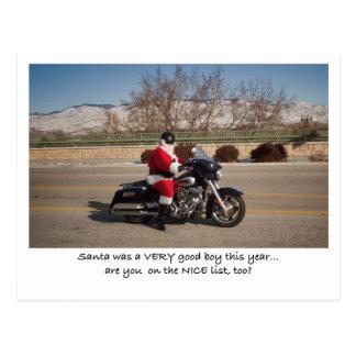 Postal del muchacho de Papá Noel del motorista bue
