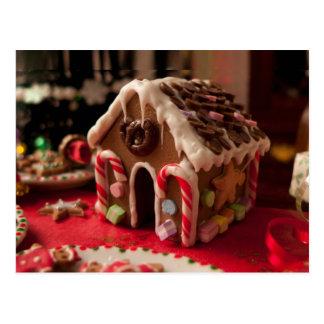 Postal del navidad de la casa de pan de jengibre