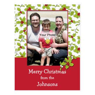 Postal del navidad de la foto del acebo y del muér