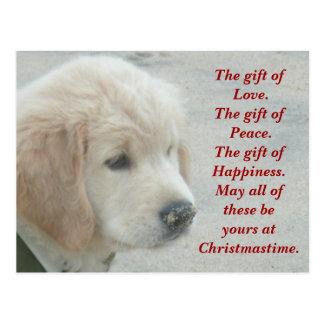 Postal del navidad del perrito del perro del golde