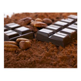 Postal del polvo de la barra y de cacao de chocola