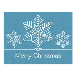 Postal delicada del navidad de los copos de nieve