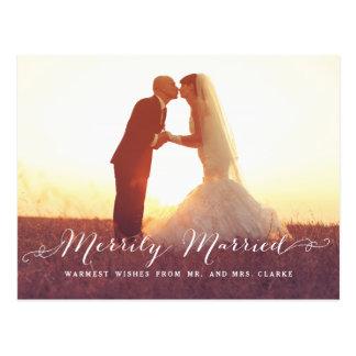 Postal feliz casada del día de fiesta de la foto
