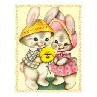 Postal linda de los niños de los conejitos de pasc