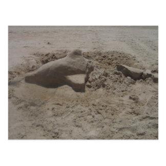 Postal machacada del castillo de arena del delfín