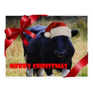Postal negra de las Felices Navidad de la vaca