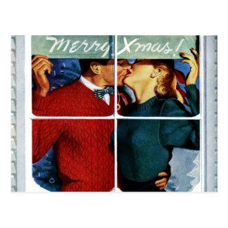 Postal retra de los pares del navidad que se besa