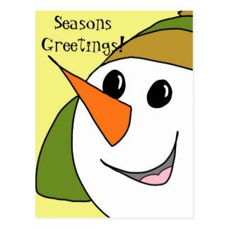 Postal sonriente del muñeco de nieve de los saludo