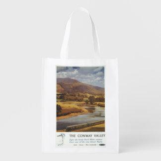 Poster británico de los ferrocarriles de la escena bolsas para la compra