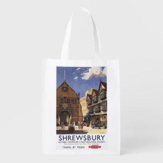 Poster británico de los ferrocarriles de la vieja bolsa de la compra