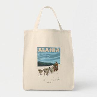 Poster del viaje del vintage de AlaskaDogsledding Bolsa Tela Para La Compra