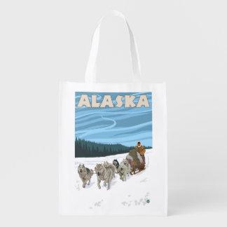 Poster del viaje del vintage de AlaskaDogsledding Bolsas Para La Compra