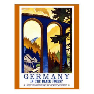 Poster del viaje del vintage del bosque negro de postal