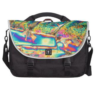 Potassium hydroxide under the microscope. laptop bag