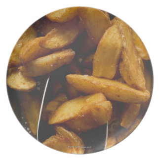 Potato wedges with salt (detail) dinner plate