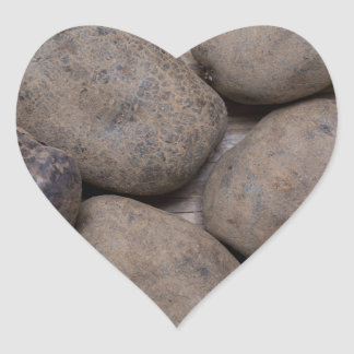 Potatoes on rustic wood Concept Heart Sticker