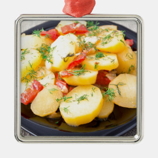 Potatoes with onion, bell pepper and fennel metal ornament