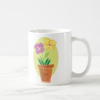 Pote bonito de flores tazas