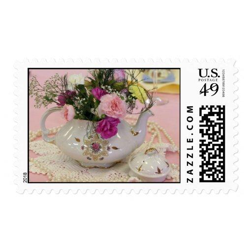 Pote del té, claveles rosados timbres postales