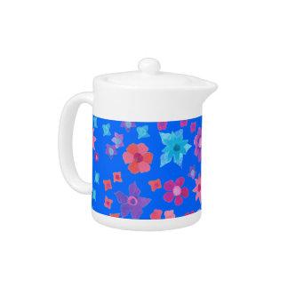 Pote del té del flower power del fondo del azul de