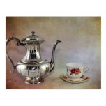 Pote del té y taza de plata antiguos de la porcela