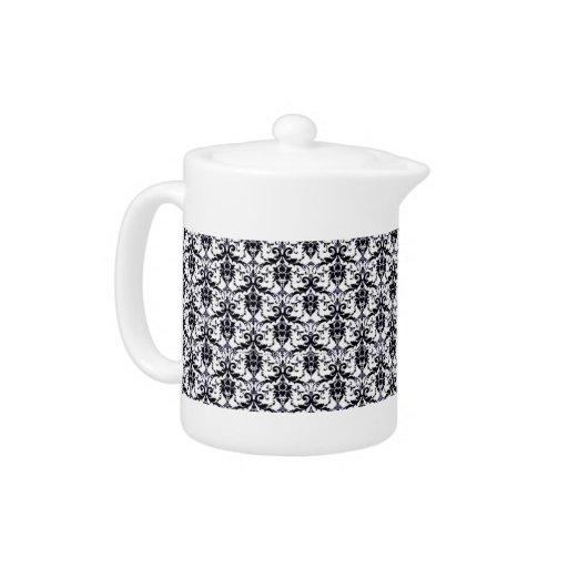 Pote elegante del té del damasco