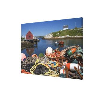 Potes de langosta, boyas, y cuerdas en el muelle e impresión en tela