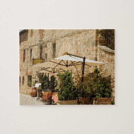 Potted plants and patio umbrellas in front of a jigsaw puzzle