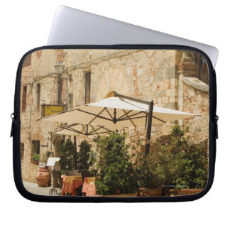 Potted plants and patio umbrellas in front of a computer sleeve