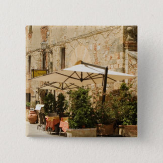 Potted plants and patio umbrellas in front of a pinback button