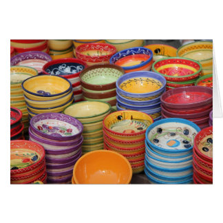 Pottery in various bright colors, card