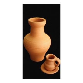 Pottery on black background card