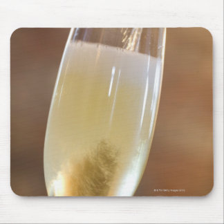 Pouring champagne mouse pads