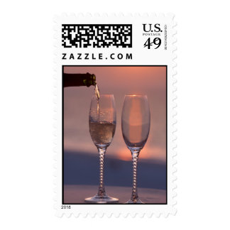 Pouring champagne postage stamp