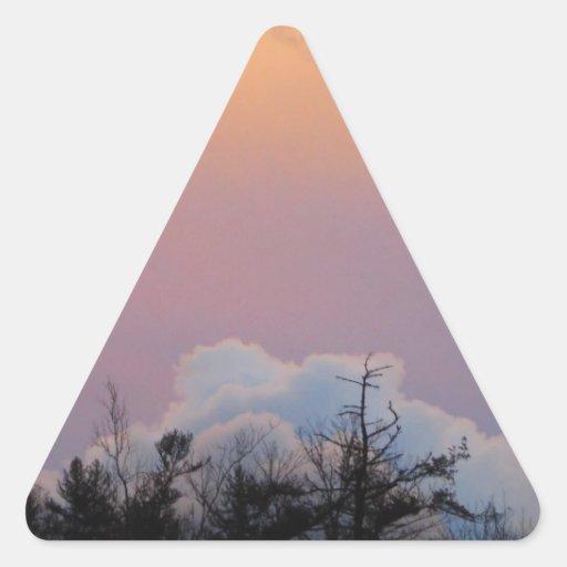 Powder blue clouds in a purple sky triangle sticker