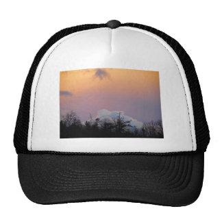 Powder blue clouds in a purple sky trucker hat