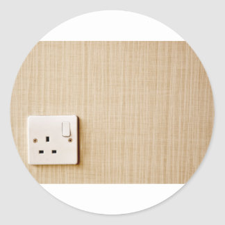 Power outlet at the corner of a wall classic round sticker