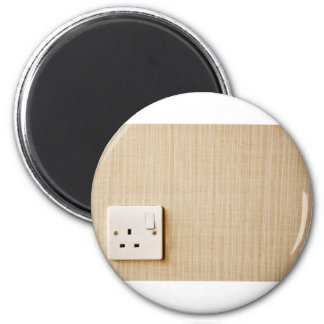 Power outlet at the corner of a wall 2 inch round magnet