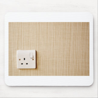 Power outlet at the corner of a wall mouse pad