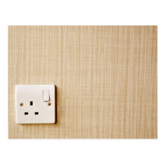 Power outlet at the corner of a wall postcard