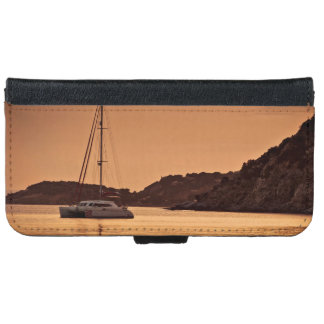 Powerful boat near shore of rocky hills iPhone 6/6s wallet case