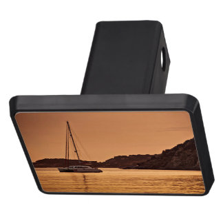 Powerful boat near shore of rocky hills tow hitch cover