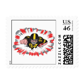 powerful football player charging hard stamps