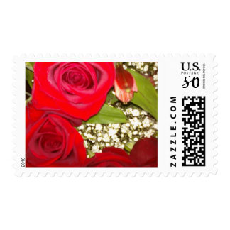 pPostal stamp with a picture red roses, etc:
