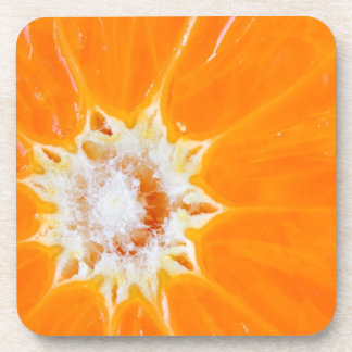 Práctico de costa anaranjado jugoso de la bebida d posavasos de bebida
