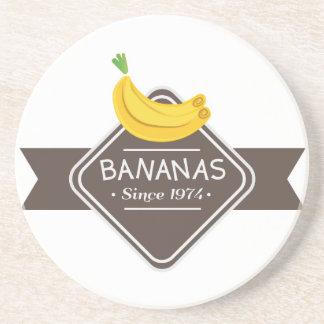 Práctico de costa del logotipo de los PLÁTANOS Posavasos Diseño