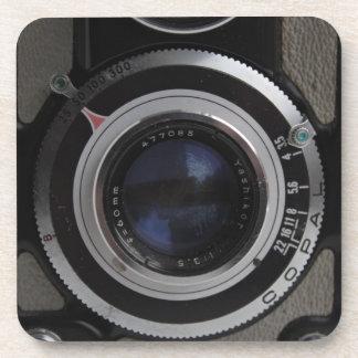 Práctico de costa gemelo de la cámara de la lente  posavaso
