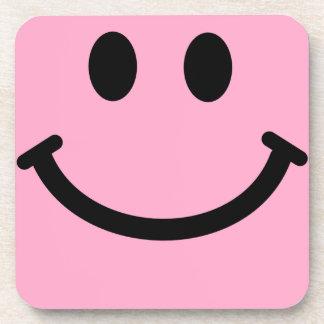 Práctico de costa sonriente rosado del cuadrado de posavaso